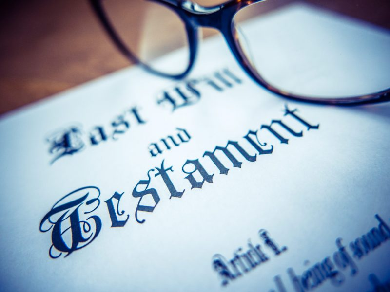 Retro Styled Detail Of A Last Will And Testament Document With Glasses